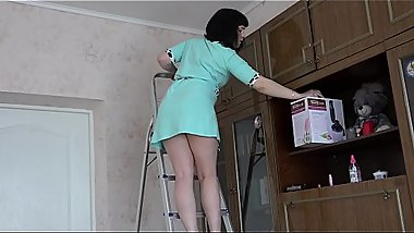 Brunette with a juicy ass makes cleaning and gradually undresses, home video.