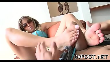 Naughty playgirl fucks mouth with foot and grinds balls and dick