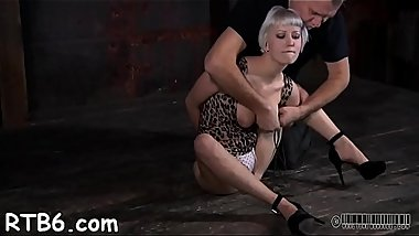 Tough angel is hoisted up and given pussy castigation