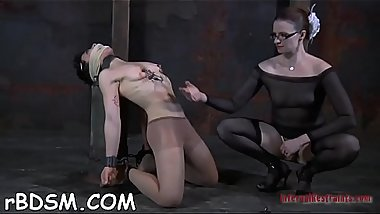 Hottie is chained in shackles during hardcore bdsm torture