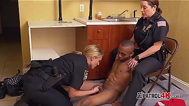 Horny milf cops undress criminal suspect to have fun with his big cock