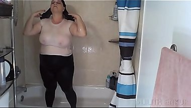 Shower In White Tank Top and Black Leggings