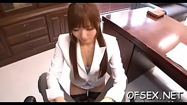 Sexy businesswoman gets amoral on the job and rides cock