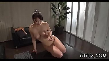Lustful japanese sucks and examines her own large hooters