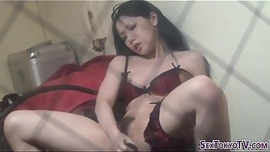 Asian beauty masturbates