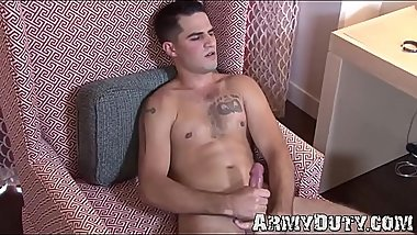 Young gay soldier twirling muscle body while masturbating