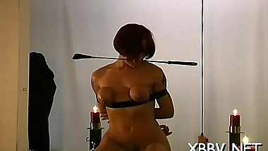 Stripped babe gets tits roughly stimulated in kinky bdsm