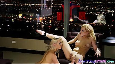 Busty squirting babe pleasured by lesbo