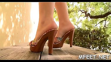Big juicy whoppers of a seductive brunette get exposed during footjob