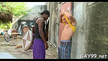 Very wicked darksome gay kneels and sucks two white penises