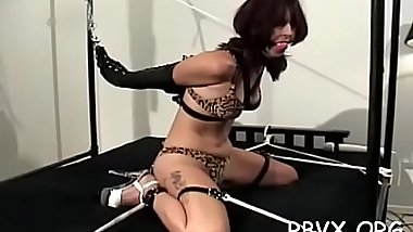 Hot bondage action as chap plays with young babe&#039_s tits and pussy